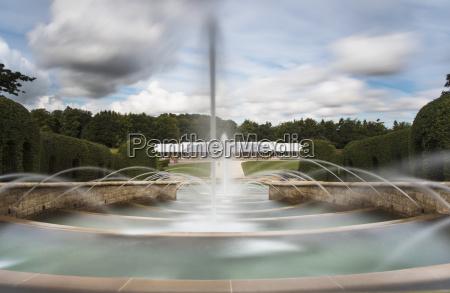 blurry motion shot of fountain spraying