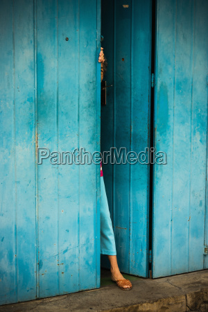 woman peeking out of doorway malacca