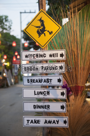 thailand post with various signs for