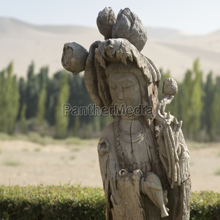 carved wooden statue of a female