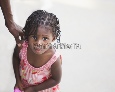 a young girl with a fearful