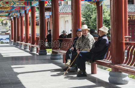 aged citizens resting and talking with