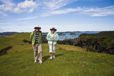 a couple walking on urupukapuka island