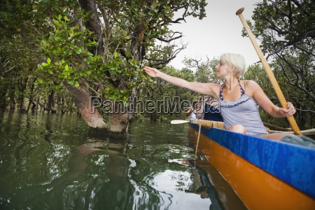 paddling on a waka with a