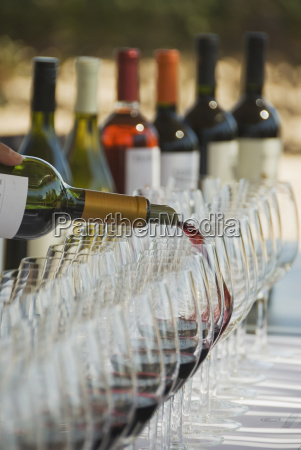 wine glasses and bottles at an