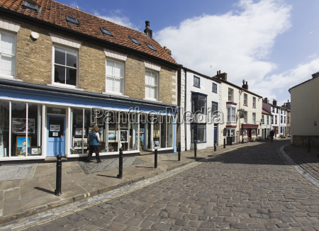 retail shops and housing along a