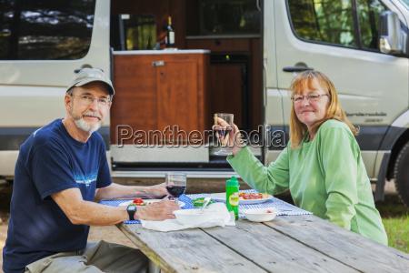 a senior couple sit at a