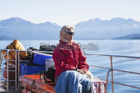 a traveler enjoying a scenic boat