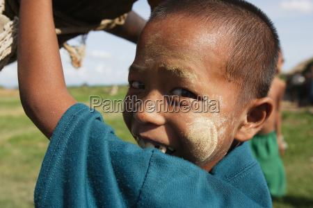 boy usng a handpump to collect