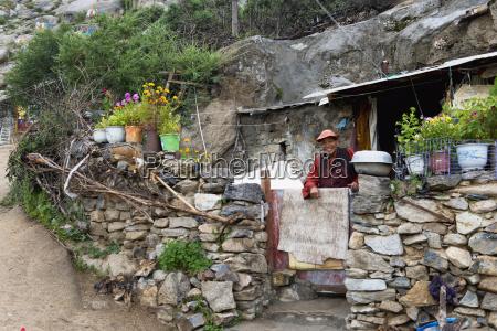 china xizang tibet nun standing behind
