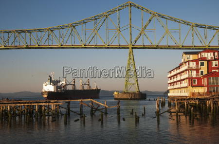 a ship passes the astoria riverfront