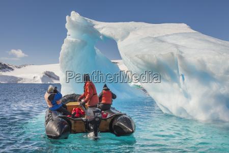 tourists view icebergs near devil island