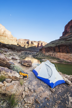 tent camped on a ledge above