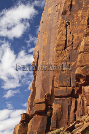 two rock climbers on their ascent