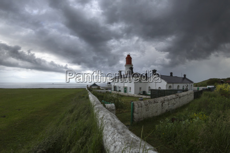 lighthouse on the coast under storm