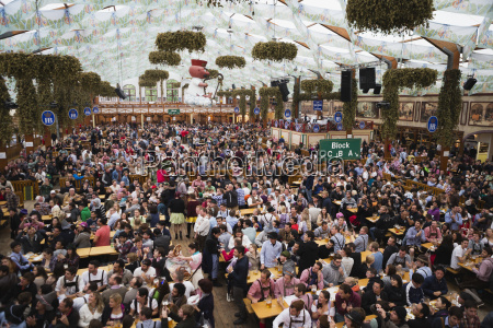 large crowd in a festival tent