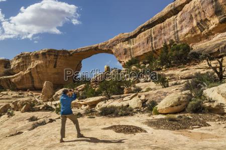 a female tourist takes a photo