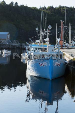 a boat moored along a dock