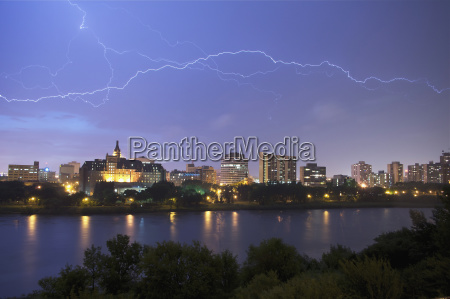lightening flashes over downtown saskatoon during