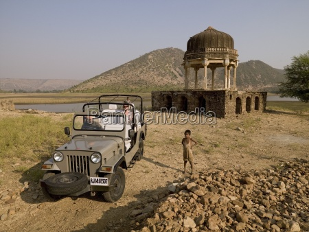 tourist sitting in off road vehicle