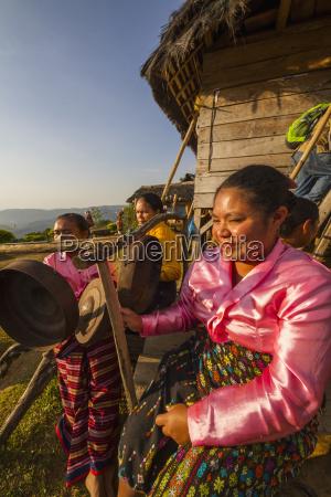 manggarai women playing percussion instruments melo