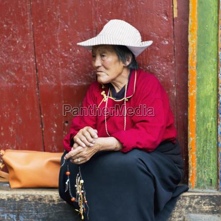 china xizang tibet woman holding beaded