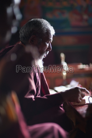 a monk in a red robe