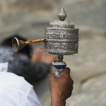 china xizang tibet man holding prayer
