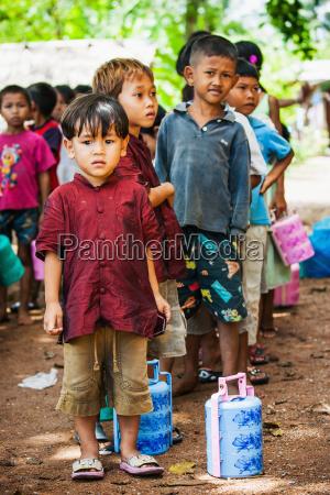 cambodia children waiting in line son
