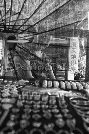a female vendor smiles behind a
