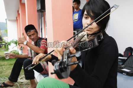 violin player accompanies a drama presentation