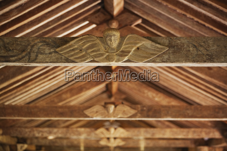 carved wooden angels in the mestizo