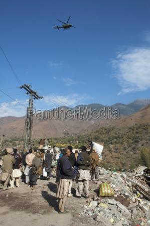 helicopter hovering above a bazaar destroyed