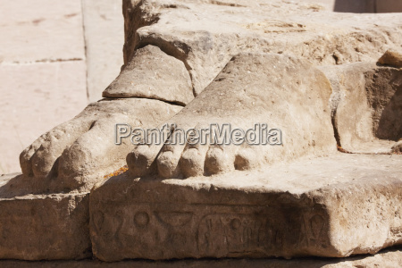 feet of the gigantic seated colossus