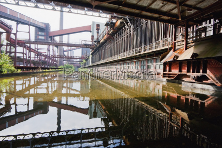coke ovens reflected in the pool