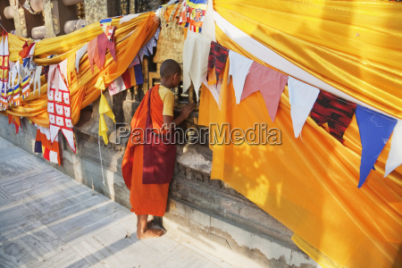 boy monk paying his respects to