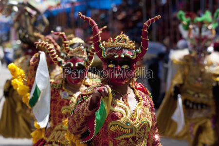 diablada dancers wearing elaborate devil masks