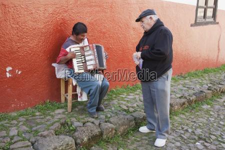 old man sings by a blind