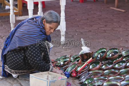 old woman selling pottery tzintzuntzan michoac