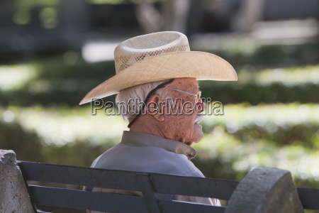 old man sitting on a bench