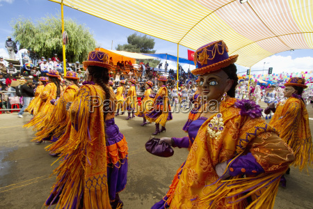 morenada dancers wearing masks in the