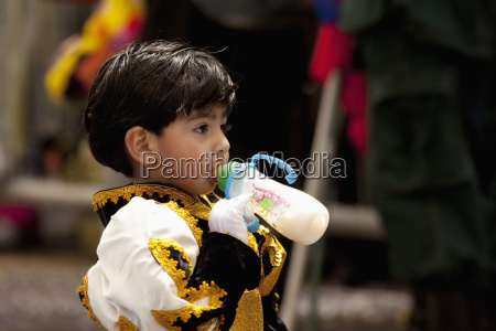 boy in a caporales dancer costume