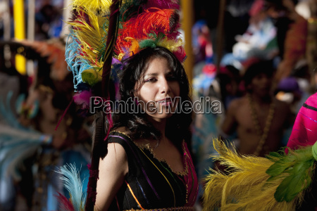 tobas dancer wearing an elaborate feather
