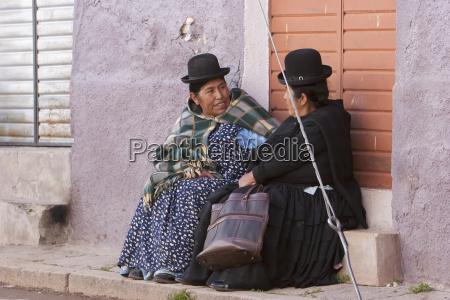 aymara women engrossed in conversation copacabana
