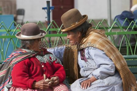 old aymara women chatting on a