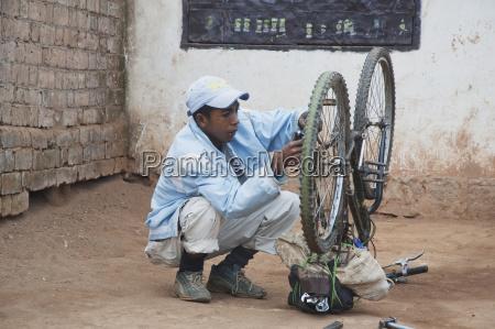 bicycle repairman in antananarivo madagascar