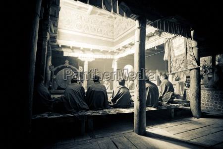 view of monks in monastery lamayuru