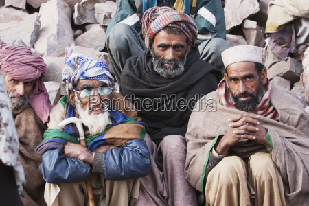 men waiting for aid and relief