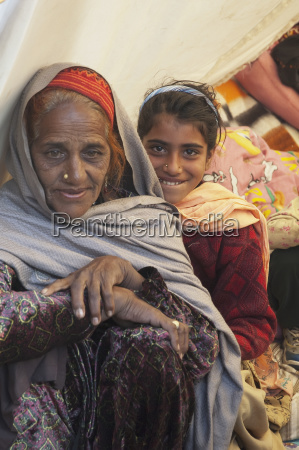 old woman and girl in a