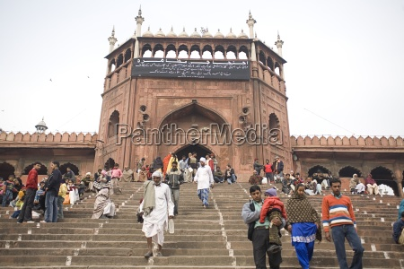 view of people walking down stairs